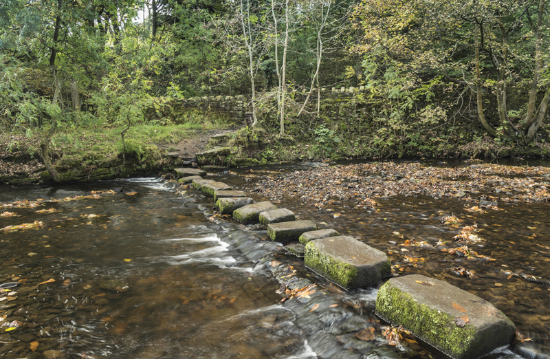 Stepping stones over river at Uppermill